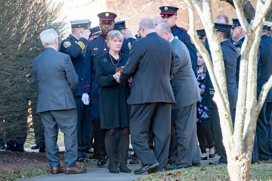 Members of the Asheville Fire Department salute as the cremains of Frank Wilford Morris, Jr. are escorted out of The Church of Jesus Christ of Latter-Day Saints following funeral services on Dec. 5, 2019. Morris was retired from the Asheville Fire Department after 25 years of service.