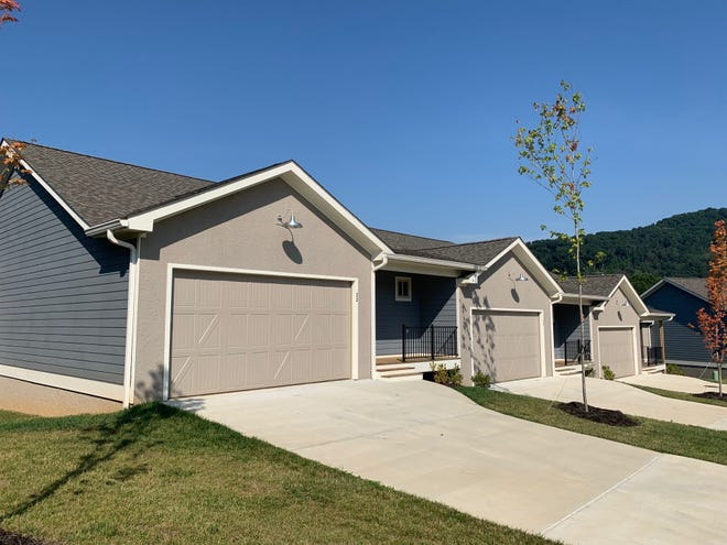 The Dillingham Woods Town Homes, located in the Haw Creek area and comprising 22 units, are now complete and being marketed.