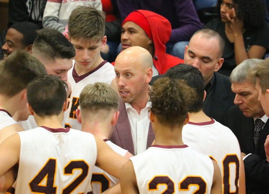 South Kitsap boys basketball coach Brian Cox talks to his players during Wednesday's 62-60 victory over Curtis.