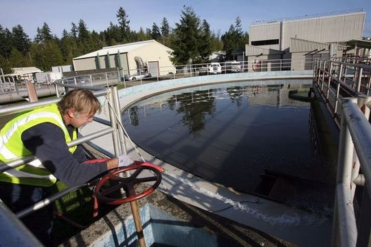 Operator Wade Iverson cleans around the primary clarifier at the Central Kitsap Wastewater Treatment Plant in this 2010 file photo.
