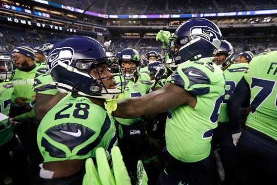 With quarterback Russell Wilson at the center, Seattle Seahawks huddle before an NFL football game against the Minnesota Vikings, Monday, Dec. 2, 2019, in Seattle.
