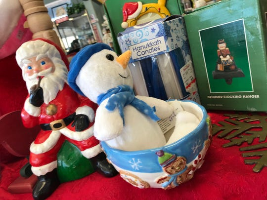 Next-to-new and vintage holiday items fill shelves at the Molly Mutt thrift store on U.S. 1 in Rockledge, where sales benefit the Brevard Humane Society.