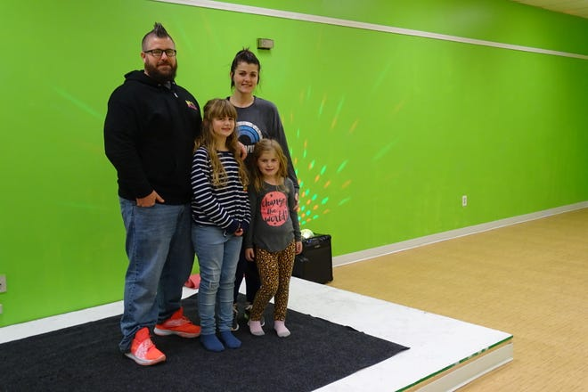 Eric and Stephanie Moore have opened Get Moore Fitness in the Southern Lights Shopping Center. Their daughters are Ella, left, and Ava.