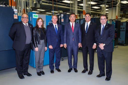 General Motors Chairman and CEO Mary Barra, Ohio Lt. Governor Jon Husted and LG Chem Vice Chairman and CEO Hak Cheol Shin are flanked by Jobs Ohio executives as GM and LG Chem announce a new joint venture that will mass-produce battery cells for future battery-electric vehicles Thursday, December 5, 2019 in Warren, Michigan. Together, the two companies will invest up to .3 billion to create a battery cell assembly plant in Northeast Ohio's Mahoning Valley. The joint venture will result in more than 1,100 new jobs. Groundbreaking is expected in mid-2020. (Photo by Steve Fecht for GM and LG Chem)