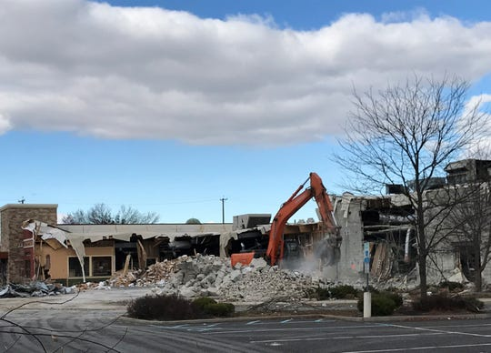 A demolition crew is razing two former restaurants to make way for a Chase Bank branch at Route 70 and Haddonfield Road in Cherry Hill.