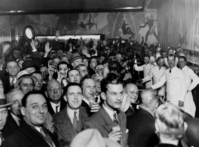 Crowds jam a downtown Chicago bar as word came from Utah that prohibition has been repealed, Dec. 5, 1933. Before the scramble for a legal drink, the crowd tossed a few hats in the air and let loose a round of cheers.