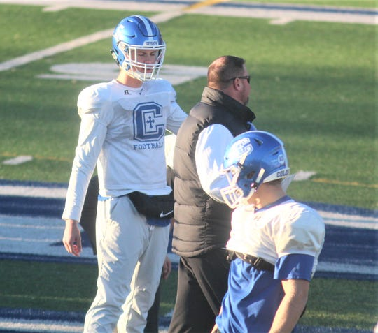 CovCath QB Caleb Jacob and head coach Eddie Eviston during practice Dec. 4, 2019