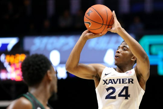 Xavier Musketeers guard KyKy Tandy (24) rises for a shot in the second half during an NCAA college basketball game against the Green Bay Phoenix, Wednesday, Dec. 4, 2019, at Cintas Center in Cincinnati. The Xavier Musketeers won 84-71.