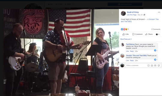 Judge Dawn Gentry, right, and Stephen Penrose in the American flag shirt, left, play at a gig at Smokin' This and That BBQ in May 2019. The judge and Penrose's alleged sexual relationship was part of a state investigation into the judge's conduct. The Enquirer took this screenshot before the band's Facebook page was taken down.