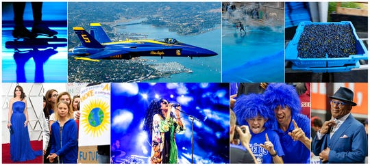 """This combination of photos shows, top row from left, Blue light projected during the opening ceremony of the ISU World Championships Speed Skating Sprint in the Netherlands, on Feb. 23, 2019, U.S. Navy Blue Angel flying over Sausalito, Calif., on  Oct. 10, 2019, Police firing blue-colored water at protestors in Hong Kong on Aug. 31, 2019, a tray of wild blueberries at the Coastal Blueberry Service in Union, Maine on Aug. 24, 2018, bottom row from left, actress-writer Tina Fey wearing a blue gown at the Oscars on Feb. 24, 2019, Swedish youth climate activist Greta Thunberg, wearing a blue sweatshirt, during a protest outside the White House in Washington on Sept. 13, 2019, H.E.R. performing under blue lights at the Coachella Music & Arts Festival in Indio, Calif. on April 14, 2019, Duke fans wearing blue wigs before an NCAA college basketball game against Florida State in Tallahassee, Fla., on Jan. 12, 2019 and """"Today"""" show co-host Al Roker wearing blue eye glasses on the set in New York on April 5, 2019. The Pantone Color Institute has named Classic Blue as its color of the year for 2020."""