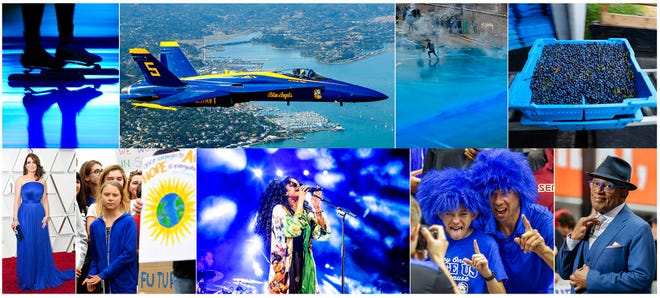 "This combination of photos shows, top row from left, Blue light projected during the opening ceremony of the ISU World Championships Speed Skating Sprint in the Netherlands, on Feb. 23, 2019, U.S. Navy Blue Angel flying over Sausalito, Calif., on  Oct. 10, 2019, Police firing blue-colored water at protestors in Hong Kong on Aug. 31, 2019, a tray of wild blueberries at the Coastal Blueberry Service in Union, Maine on Aug. 24, 2018, bottom row from left, actress-writer Tina Fey wearing a blue gown at the Oscars on Feb. 24, 2019, Swedish youth climate activist Greta Thunberg, wearing a blue sweatshirt, during a protest outside the White House in Washington on Sept. 13, 2019, H.E.R. performing under blue lights at the Coachella Music & Arts Festival in Indio, Calif. on April 14, 2019, Duke fans wearing blue wigs before an NCAA college basketball game against Florida State in Tallahassee, Fla., on Jan. 12, 2019 and ""Today"" show co-host Al Roker wearing blue eye glasses on the set in New York on April 5, 2019. The Pantone Color Institute has named Classic Blue as its color of the year for 2020."