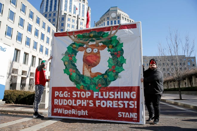 Activists with the environmental organization Stand.earth protest at Procter & Gamble's headquarters in downtown Cincinnati Thursday, December 5, 2019. The activists called out the Charmin executives for destroying forests in Canada to make toilet paper.