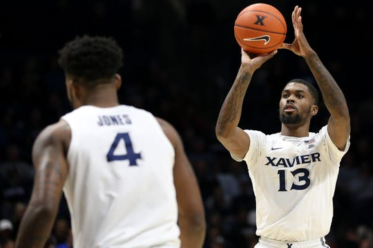 Xavier Musketeers forward Naji Marshall (13) rises for a 3-point shot in the first half against the Green Bay Phoenix during an NCAA college basketball game, Wednesday, Dec. 4, 2019, at Cintas Center in Cincinnati. Xavier Musketeers lead Green Bay Phoenix, 38-35.