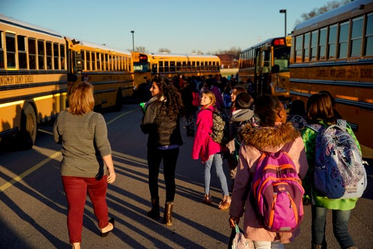 Students walk to their buses at the end of the day at Rossview Elementary School in Clarksville, Tenn., on Wednesday, Dec. 4, 2019.