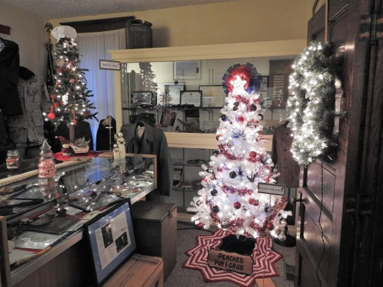 Trees donated from Roberta's Diner and Peaches Pub and Grub in the military room of the Walhonding Valley Historical Society as part of its Festival of Trees.