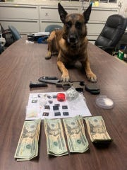 K-9 Officer Chili with items recovered from a Wednesday traffic stop that resulted in the arrest of the female driver.