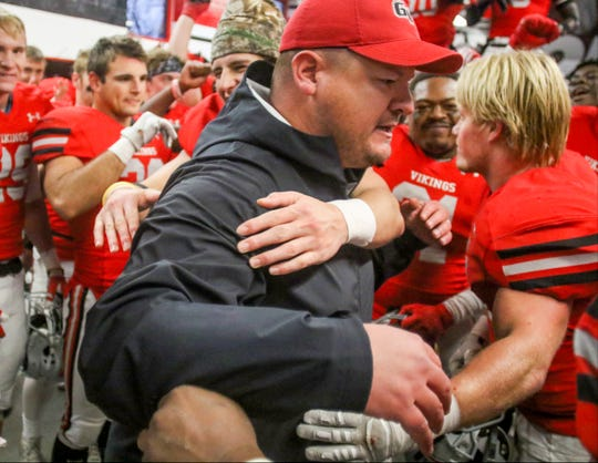 Head coach Joe Woodley celebrates with Grand View players after the Vikings defeated College of Idaho on Nov. 28, 2019 to advance to the NAIA Championship semifinals.