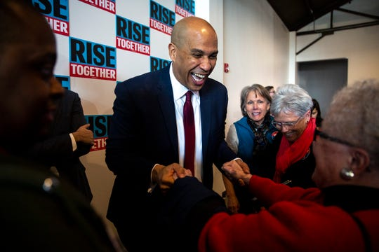 U.S. Sen. Cory Booker, D-N.J., greets people in the crowd after giving a speech about the state of his campaign and the 2020 presidential race on Thursday, Dec. 5, 2019, in Des Moines.