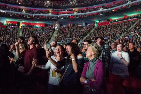 Crowds sing along during an Elton John concert at the Little Caesars Arena in Detroit, Friday, October 12, 2018.