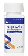 A bottle of Nuplazid, a drug that was tested for treating psychosis related to dementia.