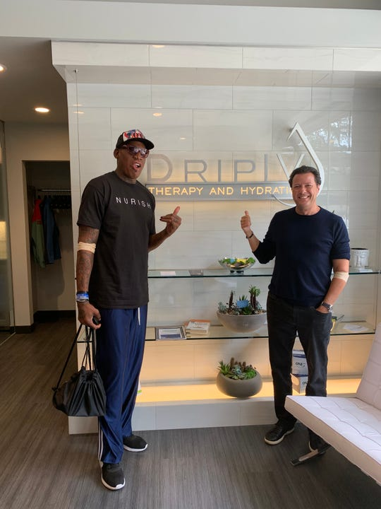 Former Detroit Piston Dennis Rodman, left, and friend Mark McManus Jr. at Drip IV Therapy in Birmingham.