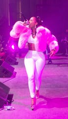 Rapper Kash Doll performs in a fur from Furluxx.