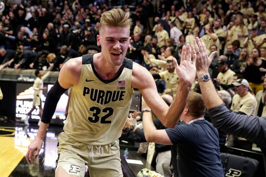 Purdue center Matt Haarms (32) celebrates with fans following the team's victory over Virginia.