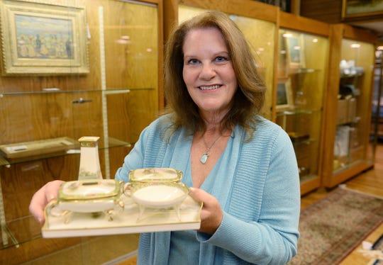 Marianne Sweet holds her vanity set.