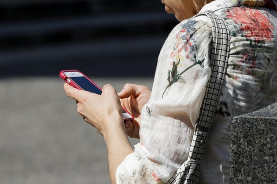 A woman browses her smartphone in Philadelphia.