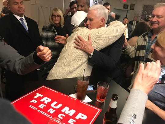 Vice President Mike Pence, center right, hugs a supporter at an American Legion hall in Grand Rapids on Wednesday, Dec. 4, 2019.