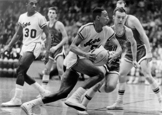 Larry Humes was part of two national championship teams and was the leading scorer on the undefeated team at 32.5 points,