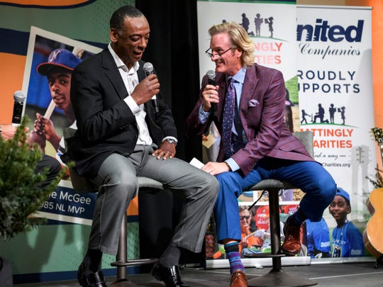 Willie McGee, left, and Steve Lyons, right, have a conversation in front of a live audience during the 5th annual Mattingly Charities Find a Way event at City View at Sterling Square in Evansville, Ind., Wednesday, Dec. 4, 2019.