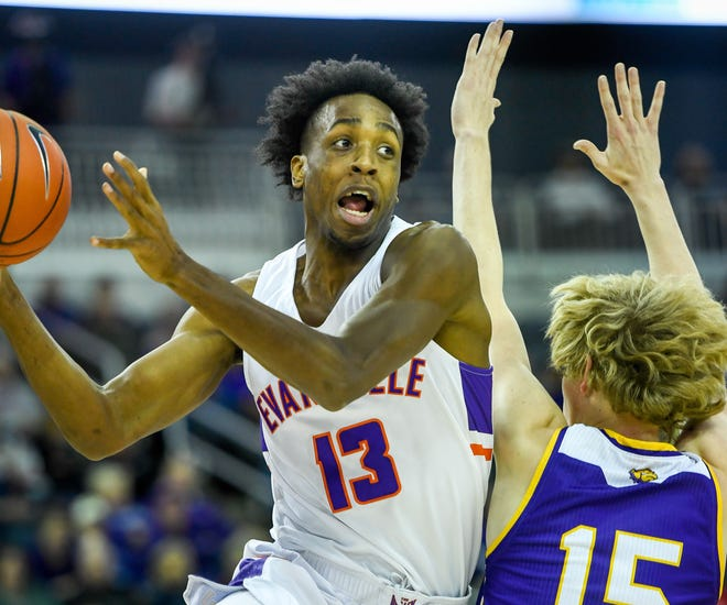 Evansville's DeAndre Williams (13) looks to pass as he drives past defense from Western Illinois' Ben Pyle (15) as the Western Illinois Leathernecks play the Evansville Purple Aces Wednesday evening at the Ford Center, December 4, 2019.