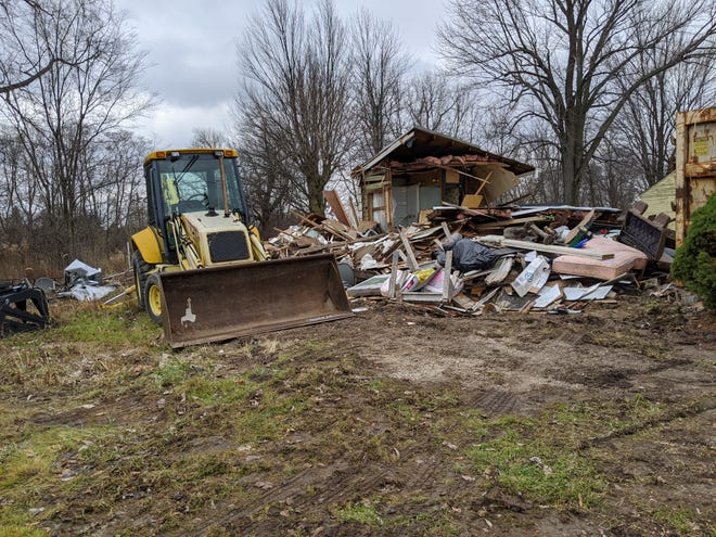 A home once owned by Ted Bundschuh on Township Road 210 is being demolished at Wightman's Grove.
