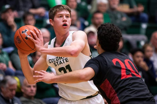 Colorado State University sophomore forward Adam Thistlewood (31) looks to pass over San Diego State University junior guard Jordan Schakel (20) on Wednesday Dec. 4, 2019, at Moby Arena in Fort Collins, Colo.