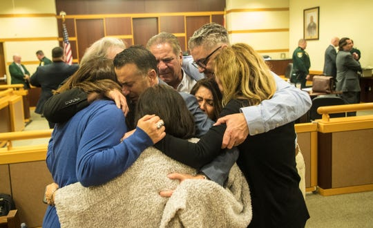 Family and friends of Teresa Sievers react after a guilty verdict is read in the trial of Mark Sievers on Wednesday Dec, 4, 2019. .