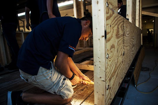 Daniel Trejo-Garcia, who is in the new Career Pathways program at Immokalee Technical School, helps to build a float Dec. 5, 2019. The float will be shown in the Christmas parade. The program offers students a chance to learn a career that focuses on construction or engineering. They will start building homes in Immokalee starting in March.
