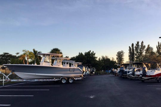 Boats are brought just outside Sun Splash Family Waterpark in preparation for the fourth annual Cape Coral Outdoor Expo & Boat Show this  weekend.