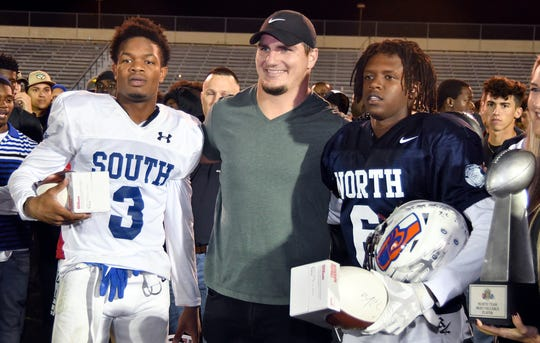 Raekwon Clark (6) and John Coleus (3) were awarded the All Star trophy after the North and South High School Football Rotary South All-Star Classic game at the Fort Myers High School Stadium, Wednesday, Dec. 4, 2019.