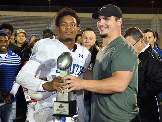 South Football Player John Coleus was awarded the All Star trophy after the Rotary South All-Star Classic game at the Fort Myers High School Stadium, Wednesday, Dec. 4, 2019.