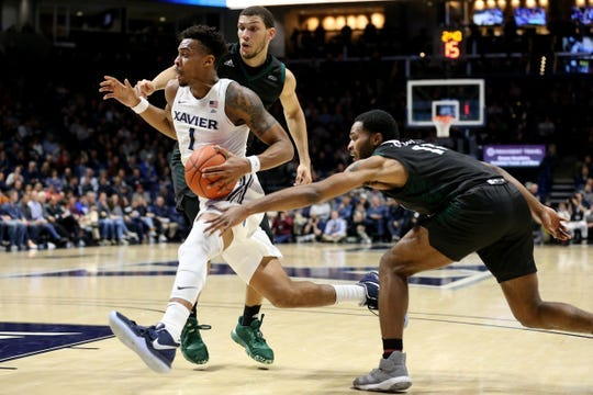 Xavier Musketeers guard Paul Scruggs (1) drives to the basket past UWGB guard JayQuan McCloud (11) in the first half on Wednesday.