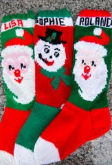 Long knitted stockings that the Wimmer family hangs in their house every year.