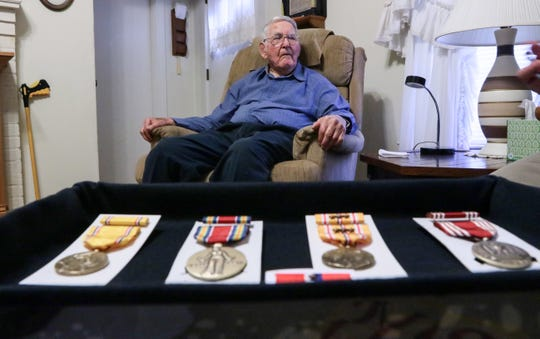 Gerald Cleveland, a World War II U.S. Army veteran who survived the Pearl Harbor attack in 1941, sits in his Anderson home in August 2017, near medals he recently received. In the case, Cleveland has the The American Defense Service Medal, left, the World War II Victory Medal, The AsiaticÐPacific Campaign Medal with Bronze stars, The Good Conduct Medal, the Philippine Liberation ribbon with bronze star, and the Honorable Service Commemorative Military Medal.
