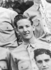 Gerald Cleveland, seen in a U.S. Army group photo taken in December 1941, was stationed at Schofield Barracks 8th Field Artillery unit of the 25th Infantry Division in Hawaii. Cleveland said the photo was taken days before the attack on Pearl Harbor.