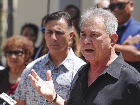 Attorney David Lujan speaks during a press conference June 7, 2016, outside the Cathedral Pastoral Center in Hagåtña. Moments earlier, Walter Denton, 52, seen behind Lujan, announced that he was sexually abused in April 1977, by then-Father Anthony Apuron when he served as an altar boy at the Agat Church.