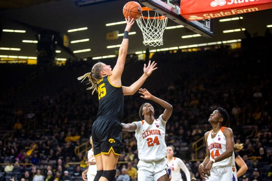 Iowa center Monika Czinano (25) makes a basket as Clemson's Mikayla Hayes (24) and Kobi Thornton (44) defend during a NCAA non-conference women's basketball game in the Big Ten/ACC Challenge, Wednesday, Dec. 4, 2019, at Carver-Hawkeye Arena in Iowa City, Iowa.