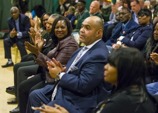 South Bend Common Council member Sharon McBride and the Rev. Rickardo Taylor applaud during an event to out Mayor Pete Buttigieg's accomplishments in the city.