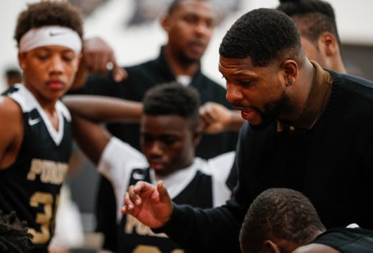 Former Purdue basketball player David Teague, now the head coach for Purdue Polytechnic, talks with players during a timeout against Indiana Deaf at Indiana School for the Deaf, Indianapolis, Dec. 4, 2019.
