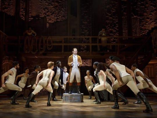 "Joseph Morales, center, will portray Alexander Hamilton when ""Hamilton"" is presented at the Murat Theatre in Old National Centre."