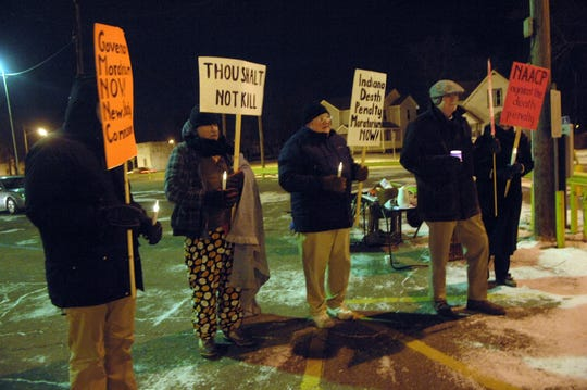 A group of protesters mainly from the Duneland Coalition to Abolish the Death Penalty braved the 11 degree temperature for Matthew Eric Wrinkles.